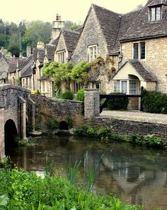 Cotsworld style houses along the Bybrook river in Castle Combe, England