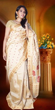 Beautiful Golden colour Muga Tassar Assam silk saree  with artistic Guna and Suta work  where anchal is mayur designed and rest with round buta giving an ethnic look to the collecion. This gorgeous Muga silk Saree is perfect for any festive occasion. The Saree comes with matching blouse piece, the blouse shown in the image is just for display purpose.