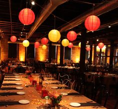 Red and yellow paper lanterns in a cozy indoor setting. Image courtesy of Erin at Exclusive Events, Inc.
