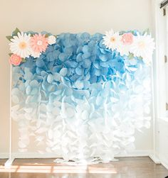 ***This backdrop does NOT include the paper flower pieces.** This gorgeous blue ombre paper garland backdrop would be a stunning accent for birthdays, weddings, or any other special occasion. This airy garland captures light beautifully to create a whimsical backdrop for any event.