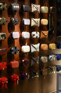 clutch storage - something similar but with hooks for purses. display everything.