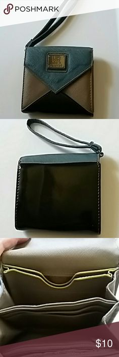 Kenneth cole wristlet. Smaller, wallet size wristlet. NEW. Never used. Holds lots of cards,cash and has zipper compartment for change. Has snap closure. It is Tri-colored , see in pics. Kenneth Cole Reaction Bags Wallets