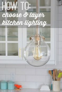 How to choose and layer lighting when designing a kitchen. We chose pendants over our peninsula, potlights, under cabinet lighting, and a pendant over the sink in our gray and white kitchen. Click to find out where we snagged our lights and our other tips over on the blog.