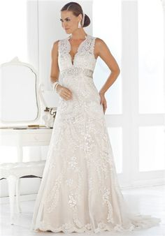 A-line sleeveless V-neck empire waisted gown with a satin band that is adorned with crystal and beading in the front.  It has an illusion back with button closeure detail and a chapel length train.