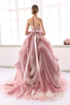 chiffon gathers on the back of the soft blush gown