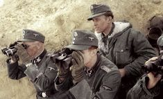 """Officers of the Waffen-SS Panzer Division """"Wiking"""" survey the battlefield in preparation for an assault. Soviet Union, Spring, 1942."""