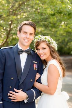Mikkel Paige Photography photo of a Duke Chapel wedding with the groom in his navy Air Force uniform and bride in a lace cap sleeve gown and baby's breath flower crown.