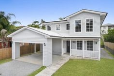 Hamptons Style Home with Carport - Breezeway House. An excellent family home design with a perfect balance of entertainment and family privacy. Downstairs is the heart of the home with a grand open-plan living connected to a large alfresco.