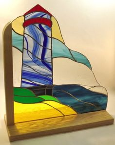 A freestanding lighthouse themed piece with a base in Ash