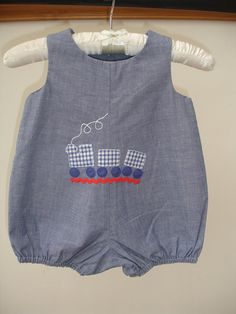 Individually handmade for that special little boy A Beautiful Indigo Blue soft denim romper suit with buttons down the back. they look lovely with or without a -shirt on a hot summers day. The Front has been appliqued with a train made of good quality material To fit a baby boy aged 6- 9 months The Romper suit will be carefully packed to reach you in a good condition They will be delivered within 2 - 3 working days Thank you for looking Debi