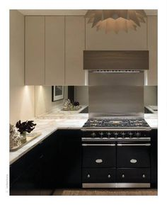 Clever use of mirror splash backs to give illusion of bigger space and more light