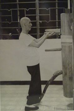 Wing Chun Grandmaster Ip Man practicing on a wooden dummy in 1967.3