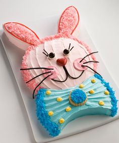 "Bunny Cake - super easy, it's 2 circle cakes, one cut into the bow, which leaves the curves for the ears. This one is nicely decorated, I usually make mine with coconut topping the cake for ""fur"", jelly beans for eyes and nose and twizzlers for whiskers. Easy but impressive."