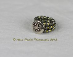 Memory wire ring with insignia vintage button by Bridget Blue™ SOLD OUT Memory Wire Rings, Memory Wire Jewelry, Jewelry Crafts, Jewelry Ideas, Jewelry Rings, Beading Ideas, Beading Projects, Beaded Rings, Beaded Jewelry