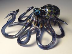 Glass sculptures are awesome and make great conversation pieces. This one was handmade by a wonderful glass artist who also makes smaller pendant versions of glass octopi.