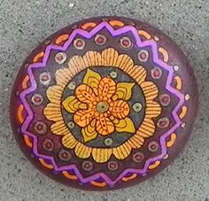 I hand-paint these unique designs on river rock, using acrylic inks and paint and sealed with polyurethane for protection. Each is one-of-kind, an