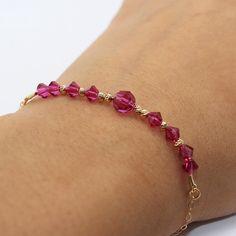 Ruby Swarovski Crystal Bracelet by MaYaJEWELRYDESIGN on Etsy https://www.etsy.com/listing/236221100/ruby-swarovski-crystal-bracelet