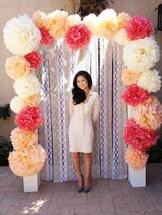 Truffled Ruffle: cream pom pom...Cute backdrop idea! Love how it looks like a picture frame. Picture perfect!