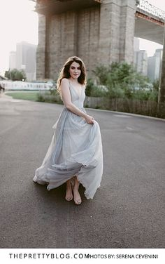 Soft pastel dress with natural makeup and hair in an inner city shoot under the Brooklyn Bridge
