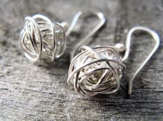 Sterling silver yarn ball earrings by AutumnEquinox on Etsy  - GOTTA HAVE!