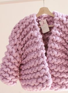 Cardigan of Merino wool. A warm cardigan made of large yarn.