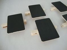 Chalk Board Clothes Pin Clips | These would be awesome to clip onto bowls at parties with the name of the food