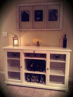 "Ikea, the best way to decorate on a budget! Purchased this ""TV stand"" and turned it into our wine buffet- Perfection!!"