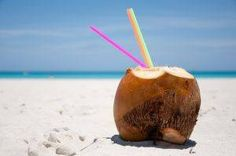Just enjoyed one of these...do a small cut and add rum. A real coconut rum drink!