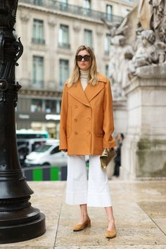 Street Chic: Style from Paris White Cropped flare pants and just the right pair of flat shoes.