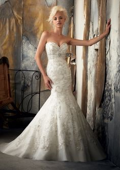 Lace applique fit and flare with crystal beading.