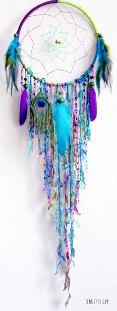 *DIY Blue Feather and Bead Dream Catcher. This dream catcher is an attractive one made with blue purple ribbons and feathers. It not only catches a dream for a good night's sleep, but certainly does wonders to your decor. Los Dreamcatchers, How To Make Dreamcatchers, Beautiful Dream Catchers, Diy And Crafts, Arts And Crafts, Kids Crafts, Adult Crafts, Diy Art, Wind Chimes