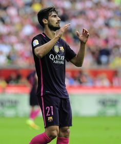 Barcelona's Portuguese midfielder Andre Gomes gestures during during the Spanish league football match Real Sporting de Gijon vs FC Barcelona at El Molinon stadium in Gijon on September 24, 2016. / AFP / ANDER GILLENEA