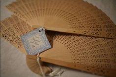 Traditional Filipino wooden fans - can attach the wedding program. This can be our Wedding Favors. Will be perfect since our wedding is an outdoor wedding in September