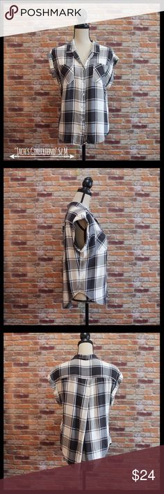 "Jachs Girlfriend Plaid Button-down Shirt Jachs Girlfriend plaid shirt in a size medium.  Two pockets on the front.  Sleeveless with folded edges.  Six buttons down the front.  Hi low hem.  Really soft.  Measures 20"" armpit to armpit, and 23"" in length in the front and 26"" in length in the back.  100% rayon.  In excellent condition. Jachs Tops Button Down Shirts"