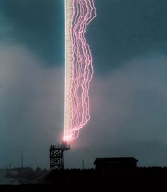 Lightning Strike.  First, researchers at the University of Florida in Gainesville captured this powerful photograph at right by firing a grounded wire into a cloud during a thunderstorm. You can see that the charge followed the wire straight down into the base tower, with other channels of electricity forming to its right.