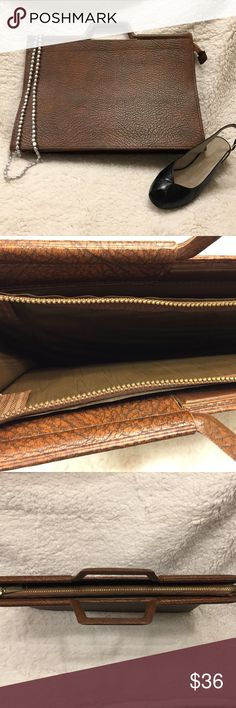 """NWOT VINTAGE Briefcase Vintage UNKNOWN Briefcase in faux leather. NWOT in excellent condition. Deep brown, brass TALON metal zipper. Approx: 16"""" wide, 11"""" tall, 5"""" thick when spread open. 60s-70s era. Mainly used to transport Papers/Manuscripts/Résumés.  Handle: 3""""x5"""". This briefcase is UNISEX.  YOU will rock your next office meeting with your Vintage Briefcase! Vintage Bags"""