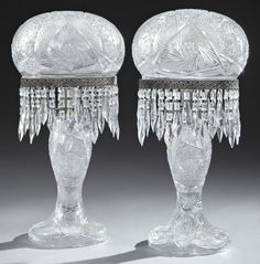 "Pair of Cut Glass and Steel ""Mushroom"" Lamps, 20th c., hung with spear prisms, with matching steel mirror bases with pierced galleries, H.- 26 in., Dia.- 12 1/4 in."