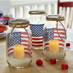 These patriotic votive holders are made using mason jars and those small flags you end up accumulating each year after your local Fourth of July parade. Sand helps keep the candles in place.