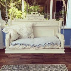 Swing made from a headboard and footboard with decorative appliques added.  What a marvelous idea!  Just gorgeous!