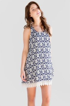 "Enjoy the springtime weather wearing the Layne Printed Dress. A classic paisley print decorates this simple sundress finished with a crochet trim along the bottom. A pair of flats & a crossbody finish off this casual look.<br /> <br /> - 36"" length from shoulder to hem<br /> - 36"" chest<br /> - 68"" sweep<br /> - measured from a size small<br /> <br /> - 100% Polyester<br /> - Hand Wash<br /> - Imported"