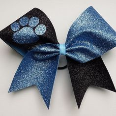 Black and columbia blue cheer bow with bow. by bragaboutitcheerbows. Explore more products on http://bragaboutitcheerbows.etsy.com