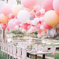 A pretty suspended balloon ceiling at an outdoor wedding by Balloonzilla; photo by Allie Lindsey Photography