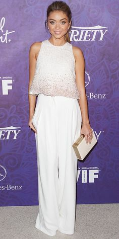 sophistication in an embellished sleeveless Georges Hobeika top and white wide-leg pants at the Variety and Women in Film Emmy Nominee Celebration, complete with a neutral box clutch and rings by Brumani and Graziela Gems. #InStyle
