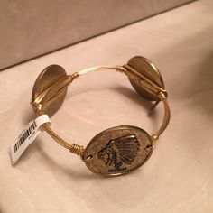 New with Tags- Bourbon and Bow ties Gold Bracelet Authentic Bourbon and Bow ties bracelet - never been worn! It's in perfect condition, just wasn't my style. It fits a small-medium wrist. Jewelry Bracelets