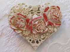 1930'S CARVED CELLULOID HEART SHAPED DRESS CLIP