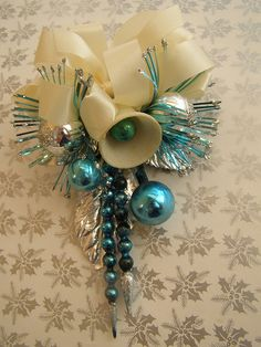 vintage christmas corsage,,i remember my mother,wearing one like this but in red to a party,when I was little...many moons ago