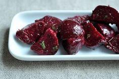 Beets and Herbs Salad - This past weekend, I tossed beets, still warm, with sherry vinegar, Dijon and olive oil. The vinegar makes their sweetness sing; the mustard gives them grit. And a spray of chopped herbs -- basil, tarragon, chives and mint -- beckons the doubters
