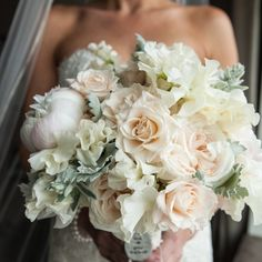 Wedding bouquet: soft shades of ivory and peach peonies, japhette orchids, garden roses, sweet pea and dusty miller.