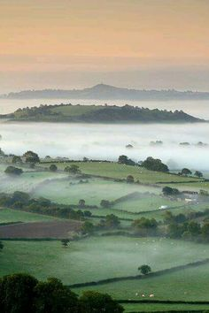 Sunrise over the hillsides of Somerset, England with Glastonbury Tor