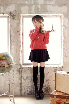 Black knee high socks, black skirt and pink sweater over collared shirt